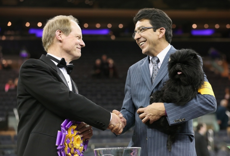 <p>Best in Show went to Banana Joe, an Affenpinscher, shown here with his handler Ernesto Lara and judge Michael Dougherty.</p>