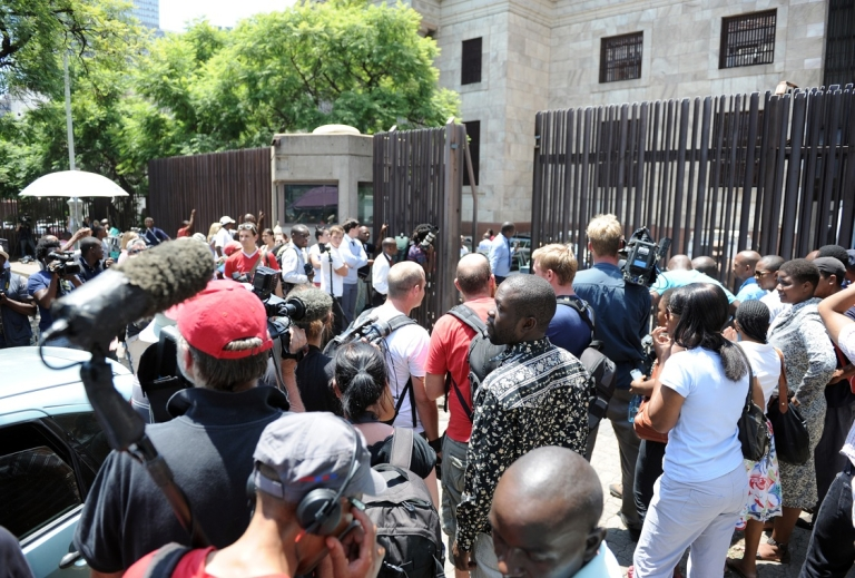 <p>A throng of reporters wait outside the Pretoria Magistrate's Court during Oscar Pistorius's first court appearance, Feb. 15, 2013.</p>