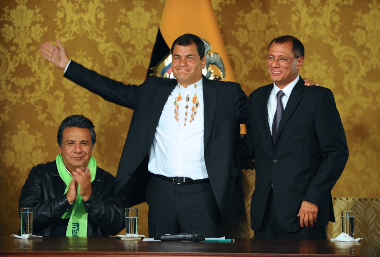 <p>Ecuadorean President Rafael Correa (C) celebrates his re-election flanked by his current Vice-President Lenin Moreno (L) and his Vice-President elect Jorge Glass, at the Carondelet presidential palace in Quito on February 17, 2013.</p>