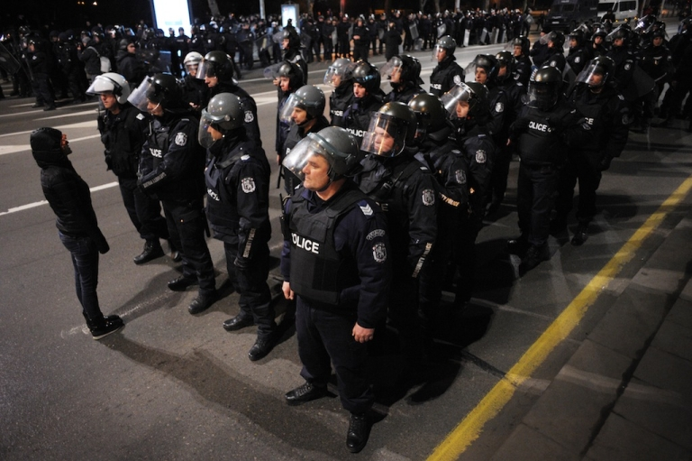 <p>A demonstrator shouts at riot police on February 18, 2013 during a protest in front of Bulgarian Parliament in Sofia.</p>