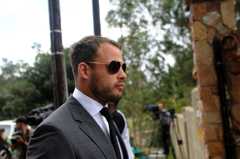 <p>South African Springbok rugby player Francois Hougaard attends a memorial for South African model Reeva Steenkamp in Port Elizabeth on February 19, 2013. Steenkamp, 29, was shot four times in the early hours of February 14, 2013 by a 9mm pistol owned by South African sporting hero Oscar Pistorius.</p>