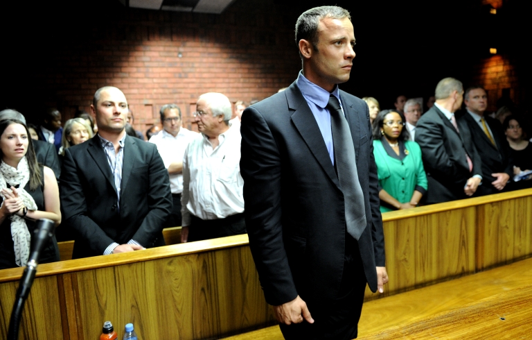 <p>South African Olympic sprinter Oscar Pistorius (C) appears on February 19, 2013 at the Magistrate Court in Pretoria. Pistorius had the terms of his bail relaxed at a hearing on March 28, 2013, though he did not attend.</p>