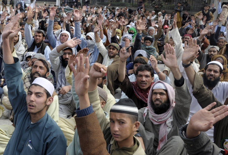 <p>Activists of religious party Jamaat Ahle Sunnat shout slogans as they sit in a protest against the Pakistani forces operation in Quetta on February 22, 2013, after the bomb attacks on Shiite Muslims . Attacks targeting Shiites in Pakistan have claimed almost 200 lives already this year. Human Rights Watch said more than 400 were killed in 2012, the deadliest on record for Shiites.</p>
