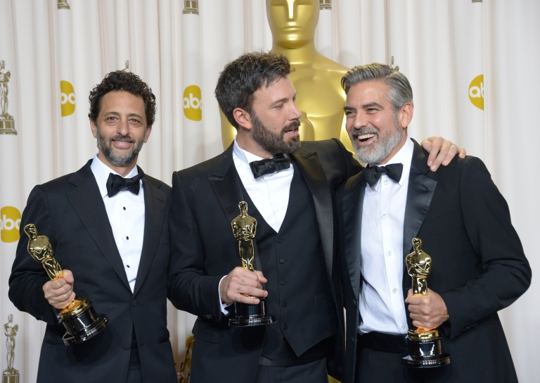 <p>Ben Affleck (C), George Clooney (R) and Grant Heslov celebrate in the press room after winning the trophy for Best Picture for 'Argo' during the 85th Annual Academy Awards on February 24, 2013 in Hollywood, California.</p>