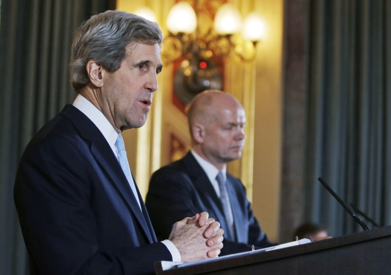 <p>US Secretary of State John Kerry, left, answers a reporter's question during a joint news conference with Britain's Foreign Secretary William Hague, right, following their meeting in central London, Monday, Feb. 25, 2013.</p>