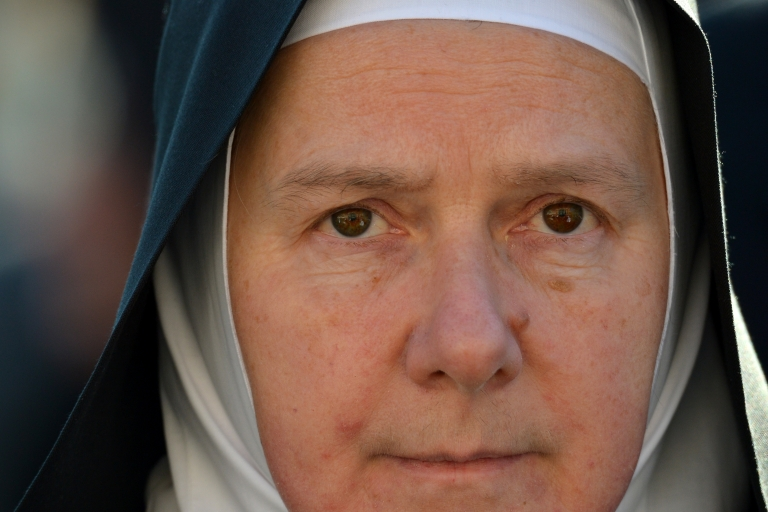 <p>A nun takes a place on St. Peter's Square ahead of Pope Benedict XVI's last weekly audience on February 27, 2013 at the Vatican, on the eve of Benedict's historic resignation as leader of the world's 1.2 billion Catholics.</p>