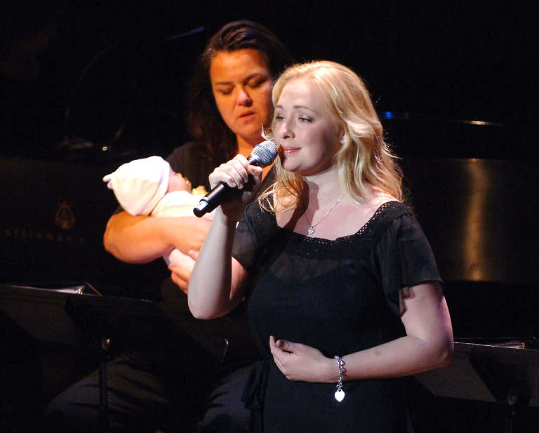 <p>Singer Mindy McCready (R) performs as Rosie O'Donnell holds McCready's three-month old baby, Zander, at the V-Day Presentation of Any One Of Us: Words From Prison at Alice Tully Hall - Lincoln Center June 21, 2006 in New York City.</p>