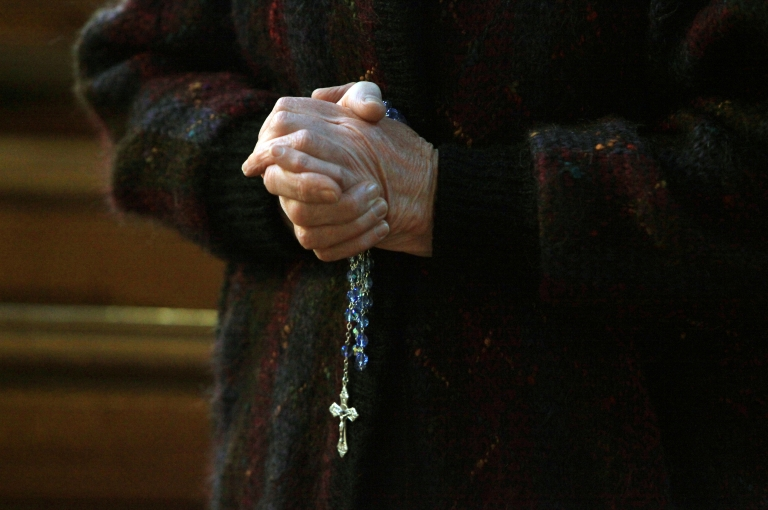 <p>A churchgoer holds a cross and rosary beads in St. Patrick's Cathedral on March 20, 2010 in Armagh, Northern Ireland as the head of the Catholic Church in Ireland, Cardinal Sean Brady, speaks. Brady voiced hope on March 20 that the pope's letter addressing sex abuse by priests could lead to