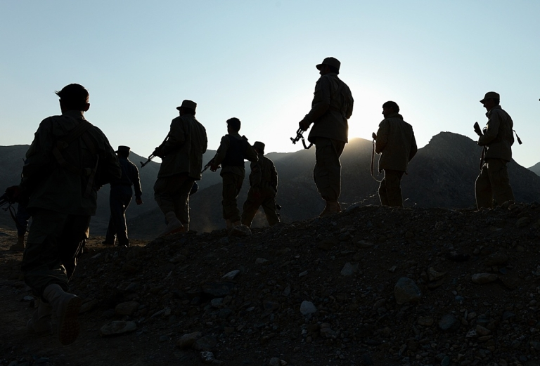 <p>In this photograph taken on December 18, 2012, Afghan Local Police (ALP) personnel patrol near their base in Goshta district of Nangarhar province. The Afghan Local Police, branded by some critics as an incompetent Taliban-linked militia, is one of the many security challenges facing the country as international troops withdraw.</p>