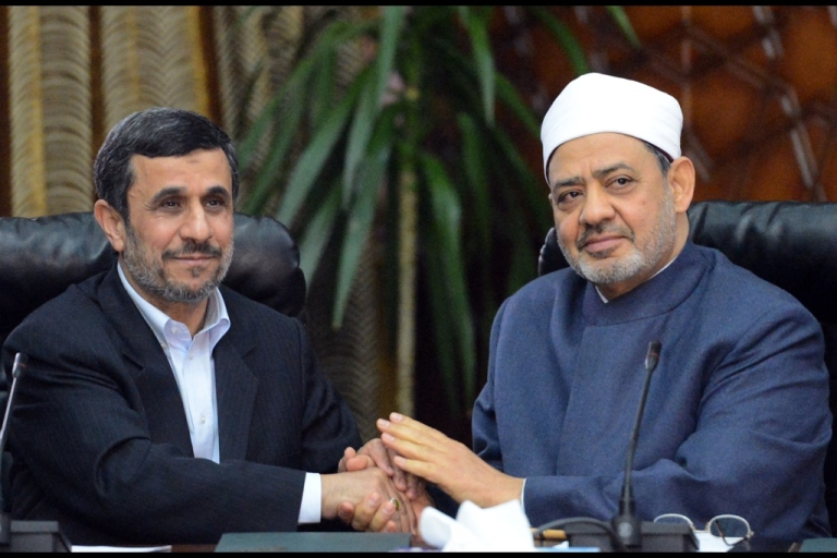 <p>Egyptian Grand Imam of Al-Azhar Sheikh Ahmed al-Tayeb (R) holds hands with Iranian President Mahmoud Ahmadinejad during a meeting at Al-Azhar headquarters in Cairo on February 5, 2013. Ahmadinejad was on the first visit to Egypt by an Iranian president since 1979.</p>