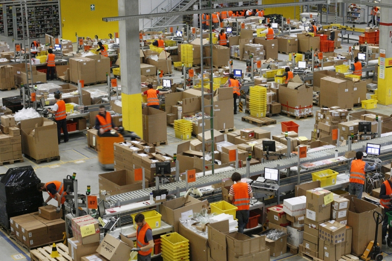 <p>Workers at online retailer Amazon's distribution center in Leipzig on Dec. 11, 2009.</p>