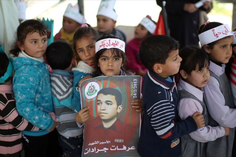 <p>A Palestinian girl carries a poster of Arafat Jaradat, who died in an Israeli prison.</p>