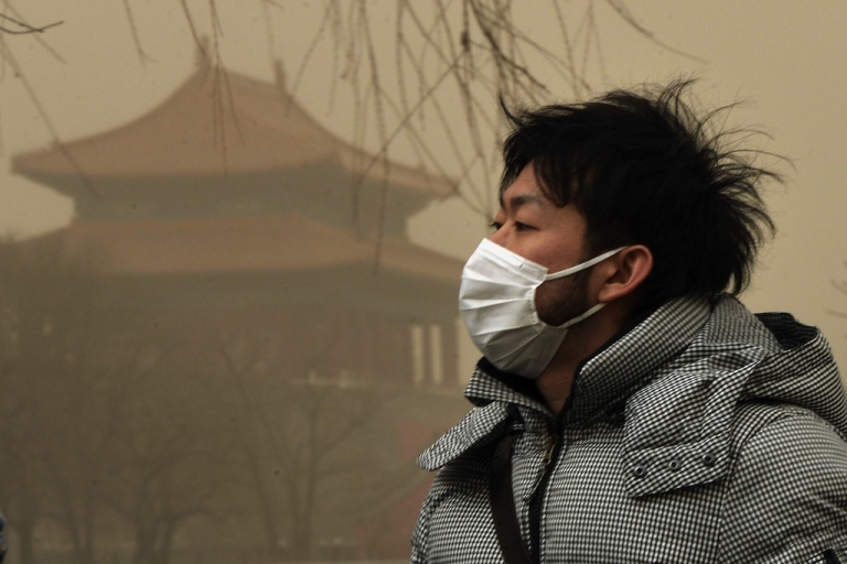 <p>A Chinese man wears a facemask as Beijing is hit by a sandstorm as well as air quality worse than the highest classification of 'hazardous' on February 28, 2013.</p>