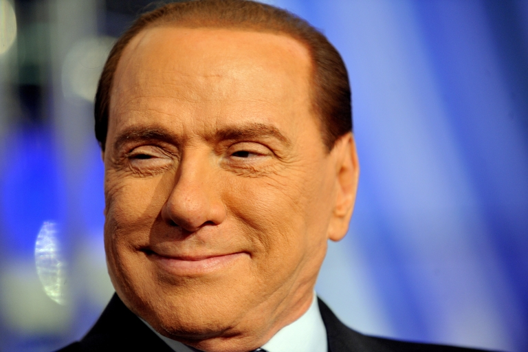 <p>Hoping to make a comeback: Many believe former Prime Minister Silvio Berlusconi represents the country's darker side.</p>