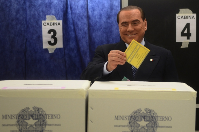 <p>Italian former Prime Minister Silvio Berlusconi casts his ballot at a polling station on February 24, 2013 in Milan. Italians fed up with austerity went to the polls on Sunday in elections where the centre-left is the favourite, as Europe held its breath for signs of fresh instability in the eurozone's third largest economy.</p>