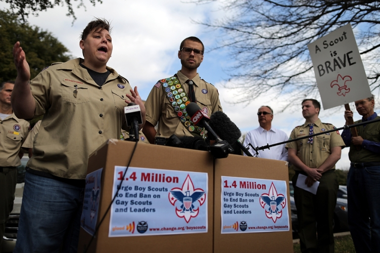<p>Jennifer Tyrrell, former Cub Scout Den Mom, and Will Oliver, Eagle Scout, address the media after delivering boxes containing 1.4 million signatures urging the Boy Scouts of America to reverse its ban on gays Feb. 4, 2013 in Irving, Texas.</p>