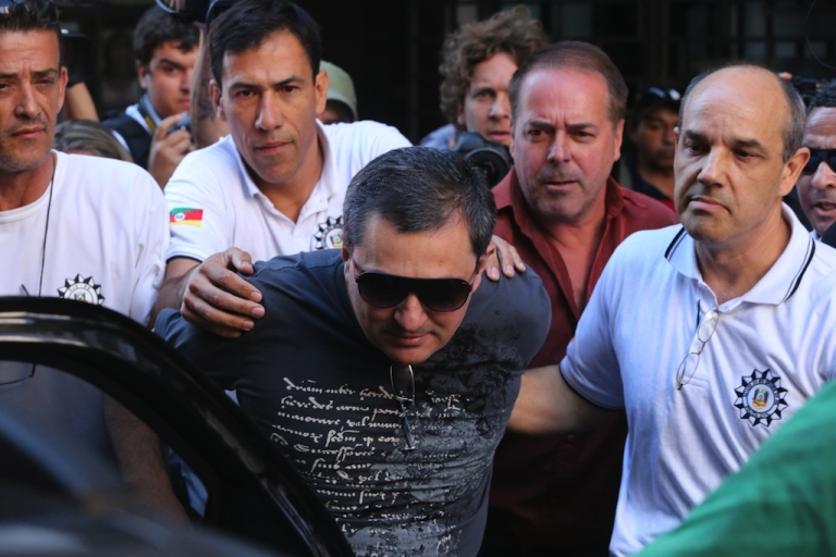 <p>Mauro Hoffman, co-owner of the Kiss nightclub where a blaze on Sunday early morning left a death toll of over 230, is taken into custody by police in Santa Maria, southern Brazil, on January 28, 2013.</p>