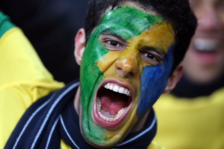 <p>From fireworks to flags almost as large as the field, Brazilian soccer matches are a riot of noise and passion.</p>
