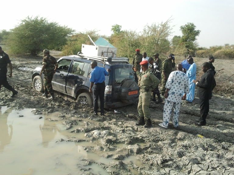 <p>Cameroonian policemen and soldiers are gathered on February 19, 2013 in Dabanga near the Nigerian border, around the 4x4 vehicle in which seven members of a French family were driving before being seized in a kidnapping allegedly carried out by Nigerian Islamist group Boko Haram.</p>