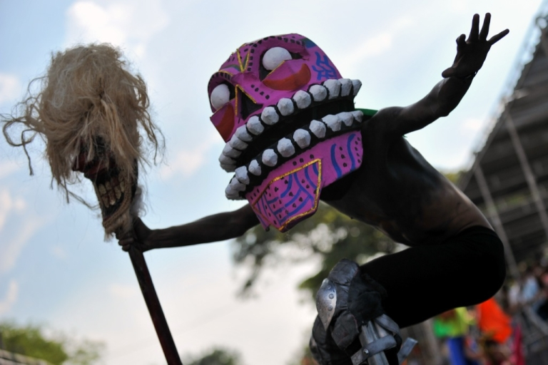 <p>While Brazil's carnival's are scheduled for next week, some Latin American countries have alreay hosted carnivals this season. Here, a reveler dances during the Carnaval de Cali Viejo parade, held on Dec. 28, 2012, in Cali, Colombia. This parade makes a tour of the popular people and most important historical events of this region of the country.</p>