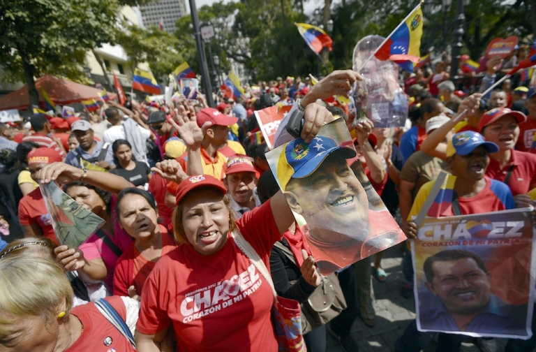 <p>Supporters of Chavez gather at Simon Bolivar Square in Caracas to celebrate their president's return on Feb. 18, 2013.</p>