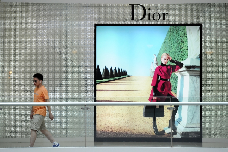<p>A shopper walks through a luxury shopping mall in Shanghai on July 26, 2012. A report from the Beijing-based World Luxury Association found that luxury spending in China last month fell to its lowest level in five years.</p>