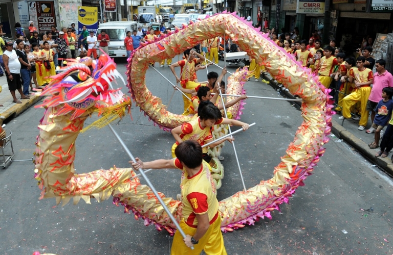<p>Performers take part in a dragon dance on the eve of the Chinese Lunar New Year of the Snake, in China town in Manila on February 9, 2013. The Dragon Dance is usually performed during the Chinese New Year to bring in good luck and prosperity as billions of Chinese world wide celebrate Lunar New Year of the Snake on February 10.</p>