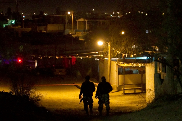 <p>Members of the Ministerial Federal Police guard a crime scene where unknown individuals threw grenades and shot at two rehabilitation centers in Ciudad Juarez, Mexico, on Dec. 5, 2010. While the Sinaloa cartel maintains a heavy presence in Sinaloa state, it has also ousted its rivals in the lucrative smuggling corridors of Tijuana and Ciudad Juarez.</p>