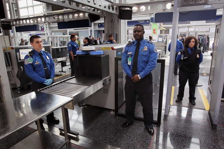 <p>Transportation Security Administration (TSA) officers staff a checkpoint at O'Hare International Airport on March 15, 2010, in Chicago, Ill. Clear, a company that makes it possible for you to save time as you check in, is now supported at Orlando International, Denver International, San Francisco International, Dallas/Fort Worth International and Westchester Airport.</p>