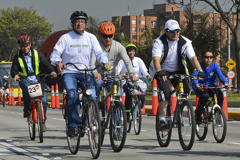 <p>Bogota's Mayor Gustavo Petro (L) rides his bike among other people during Car Free day in Bogota, Colombia, on Feb. 7, 2013. Residents of Bogota are asked not to use their cars in an attempt to reduce environmental pollution.</p>