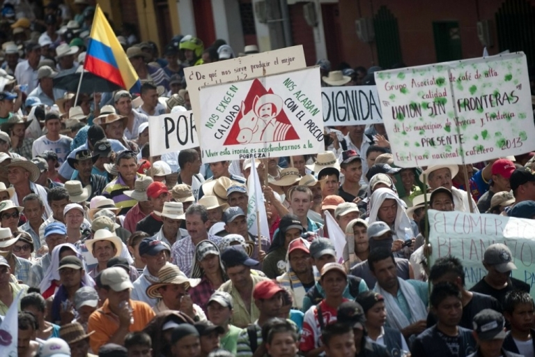 <p>Thousands of campesinos protest over hard times for Colombia's coffee sector in Bolombolo municipality, southwest of Medellin on Feb. 25.</p>