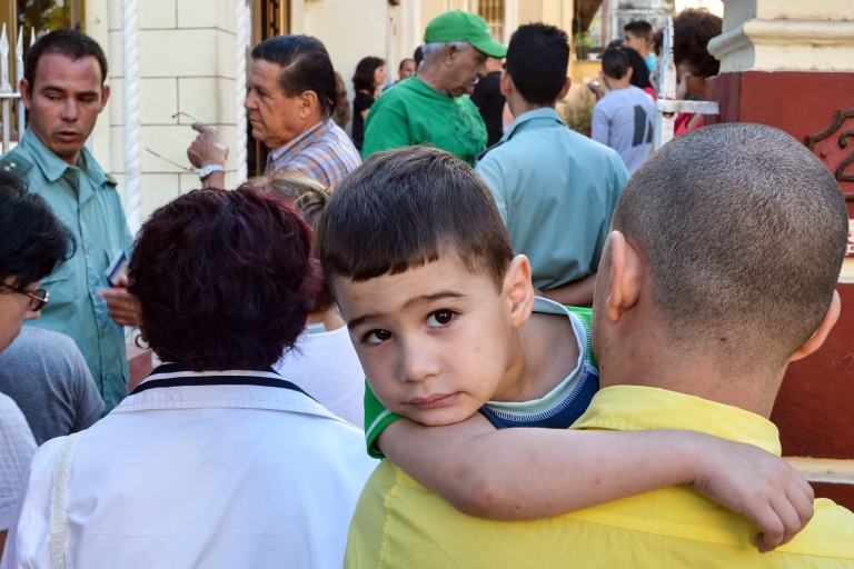 <p>Change in the air? Cubans wait to apply for passports after a new law in January allowed them to travel abroad without exit visas.</p>