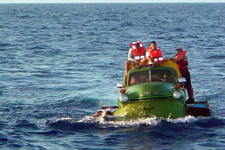 <p>Cuban migrants trying to reach the US coast in Florida ride a makeshift boat made out of a 1951 Chevrolet truck, July 16, 2003.</p>