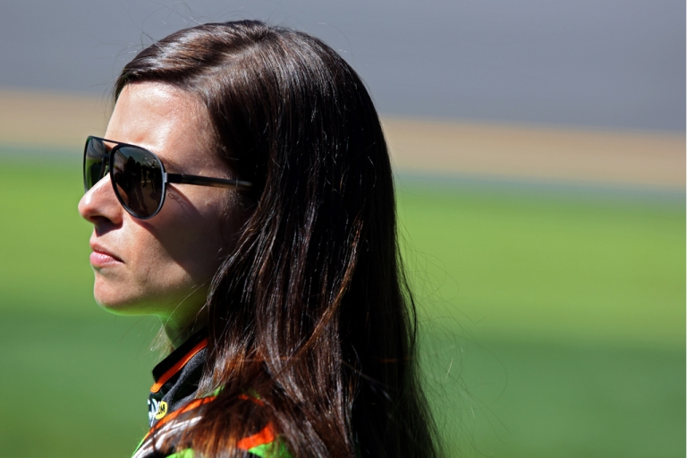 <p>Danica Patrick looks on during qualifying for the NASCAR Sprint Cup Series Daytona 500 at Daytona International Speedway on February 17, 2013 in Daytona Beach, Florida.</p>