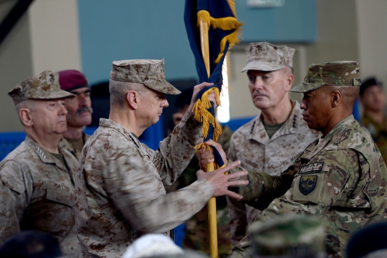 <p>Former NATO commander US General John Allen (3rd L) hands over a flag to US General Joseph F. Dunford (2nd R) as he takes over as commander of NATO in Afghanistan at the ISAF headquarters in Kabul on February 10, 2013. US General Joseph Dunford assumed command of NATO forces in Afghanistan on Sunday, taking over from General John Allen as the coalition prepares to withdraw the bulk of its combat troops by next year.</p>