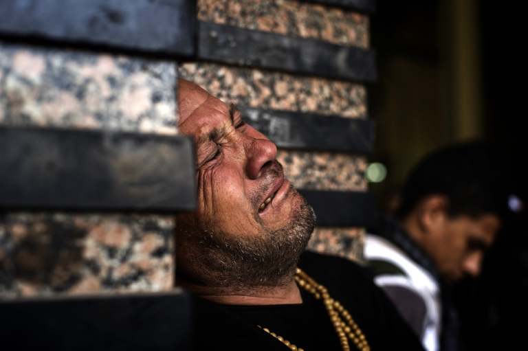 <p>An Egyptian man at the funeral of killed Egyptian activists Amro Saad and Mohammed Al Guindy outside Omar Makram Mosque in Cairo's Tahrir Square, on Feb. 4, 2013.</p>