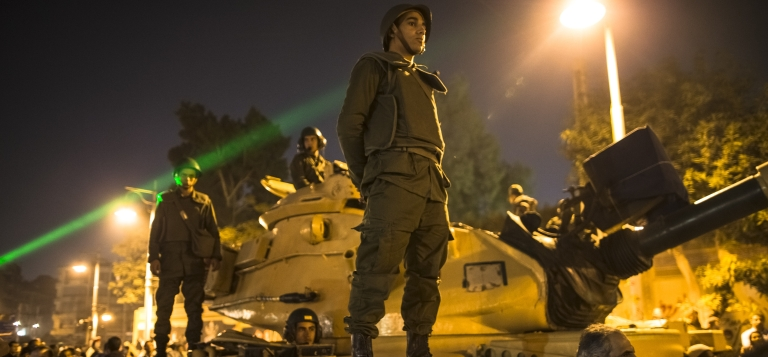 <p>Egyptian soldiers stand guard as protests mounted outside the presidential Palace.</p>