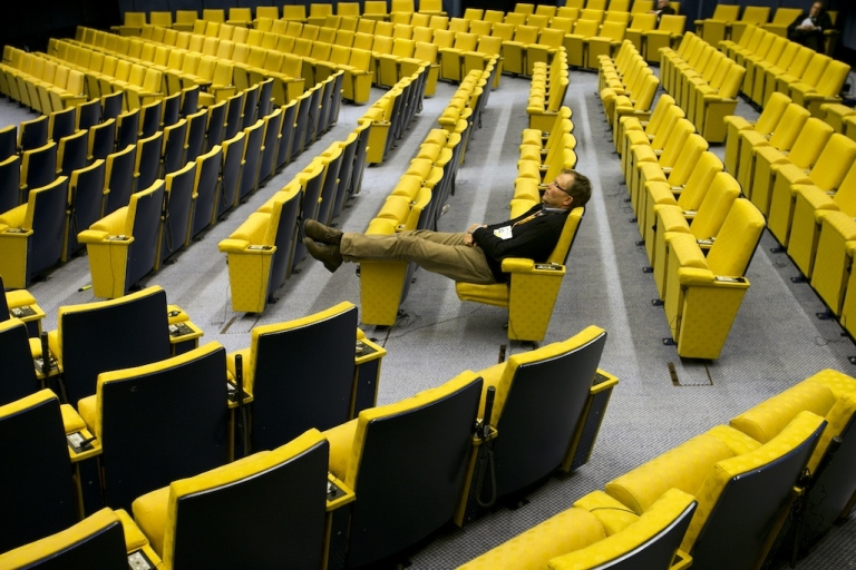 <p>A man sleeps in the main hall at the headquarters of the Council of the European Union on February 8, 2013 in Brussels, Belgium. A new report by Der Spiegel says that the US spied on the European Council building, as well as EU diplomats in the United States.</p>