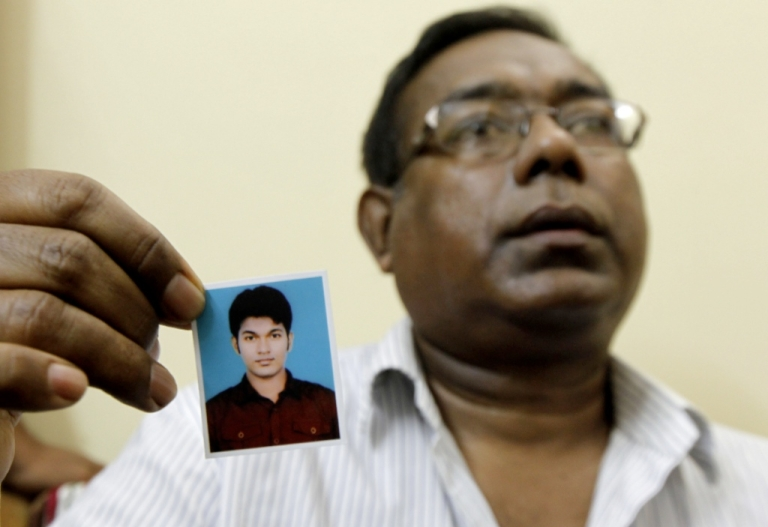 <p>The father of Bangladeshi national Quazi Mohammad Rezwanul Ahsan Nafis arrested in New York for attempting to detonate a bomb, holds a portrait of his son in Dhaka on October 18, 2012.</p>