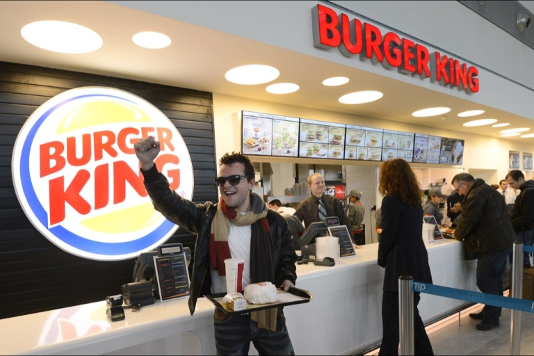 <p>A customer reacts after being served at the Burger King fast food restaurant in Marseille's airport, in Marignane, southern France, on Dec. 22, 2012. Marignane's Burger King is the first shop of the brand to open in France after 15 years of absence and marks the return of the famous Whopper burger in the country.</p>