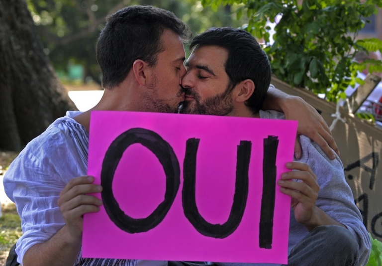 <p>Two men kiss during a demonstration in support of the legalisation of gay marriage and LGBT parenting in France at the Plaza Francia in Buenos Aires, on Jan. 27, 2013.</p>