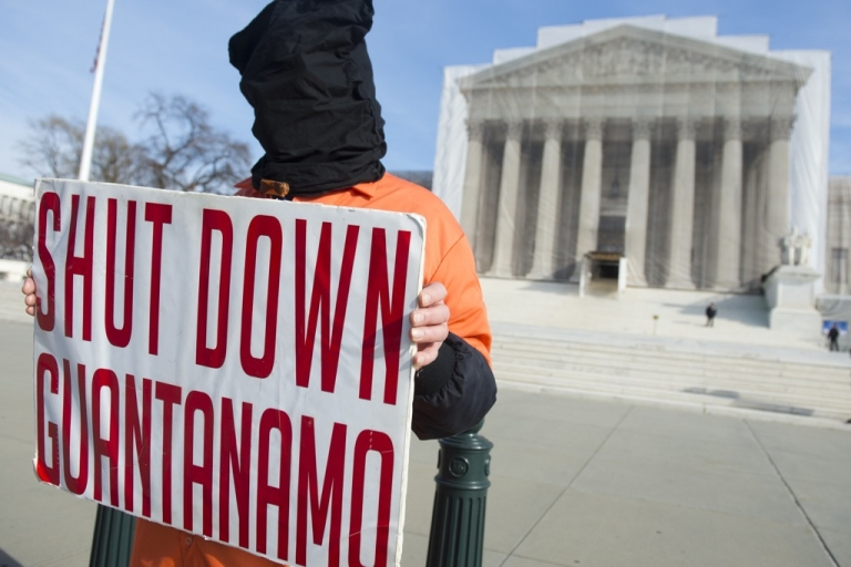 <p>A protester dresses like a Guantanamo Bay prisoner during protests against holding detainees at the US military prison in front of the Supreme Court in Washington, DC, on Jan. 8, 2013.</p>