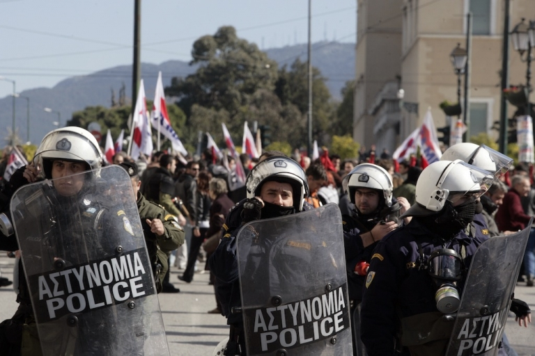 <p>Riot police outside Greece's parliament during a protest on Feb. 20, 2013 in Athens.</p>