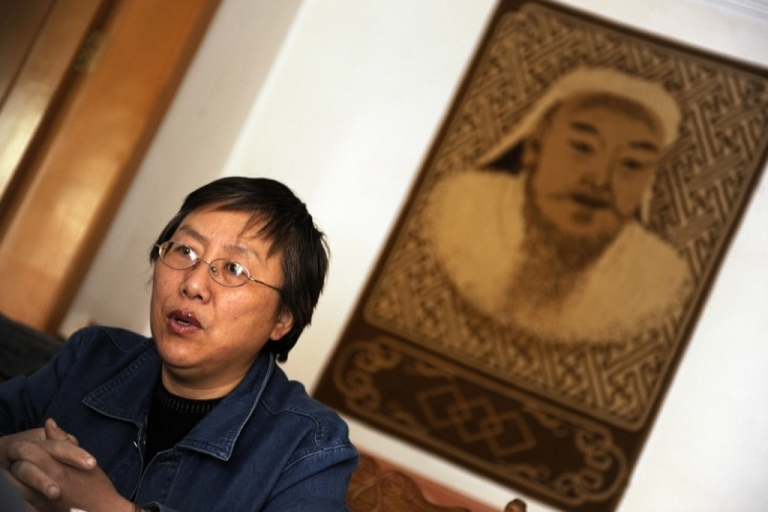 <p>Ethnic Mongolian activist Xinna, shown here on April 15, 2009 in a Mongolian restaurent in Hohhot in China's Inner Mongolia region, says that since 1995 she has has endured tight controls and harassment by anxious authorities while publicizing the plight of her ethnic Mongolian community under China, as she awaits the release of her jailed dissident husband, Hada.</p>