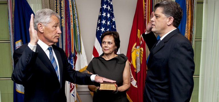 <p>As his wife Lilibet holds the bible, Chuck Hagel is sworn into office as the 24th secretary of defense at the Pentagon on Feb. 27.</p>
