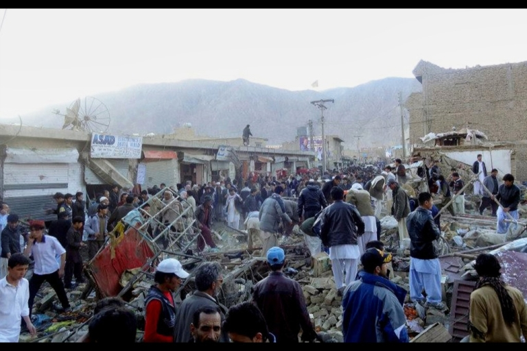 <p>People gather after a bomb targeting Shiite Muslims exploded in busy market in Hazara town, an area dominated by Shiites on the outskirts of Quetta, on February 16, 2013. The bomb killed 63 people including women and children and wounded 180 in Pakistan's insurgency-hit southwest, police and officials said.</p>