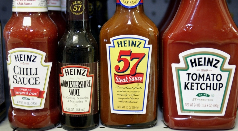 <p>H.J. Heinz Co. products are displayed at a grocery store in Chicago, Illinois. The company is being bought by Warren Buffett and Jorge Lemann.</p>