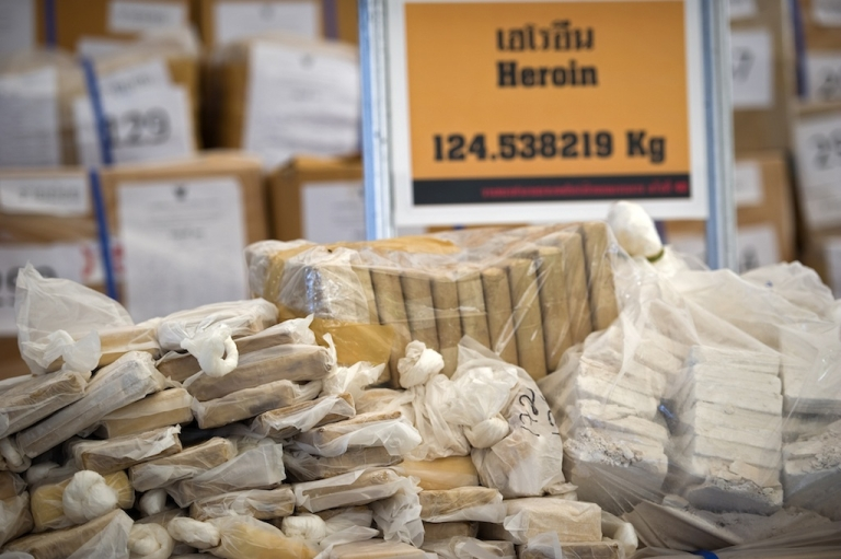 <p>Bags of heroin seized by the Thai narcotic police department.</p>
