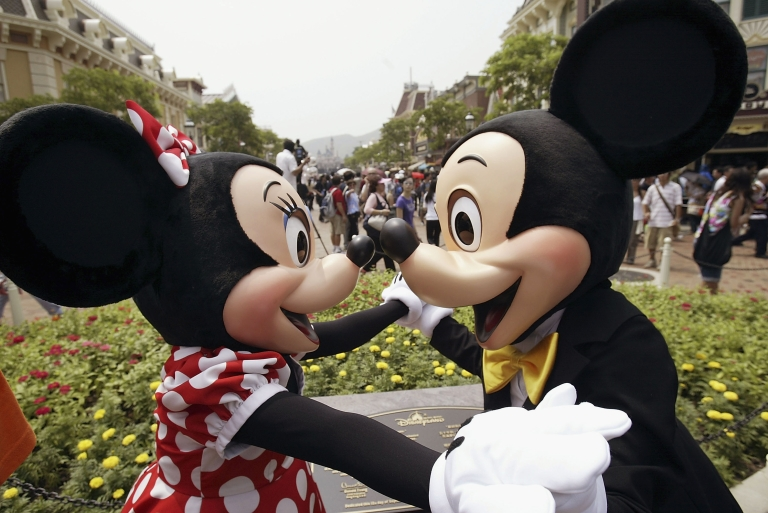 <p>Disney characters Mickey and Minnie Mouse welcome visitors during the grand opening day of Hong Kong Disneyland September 12, 2005 in Hong Kong  (Photo by MN Chan/Getty Images)</p>