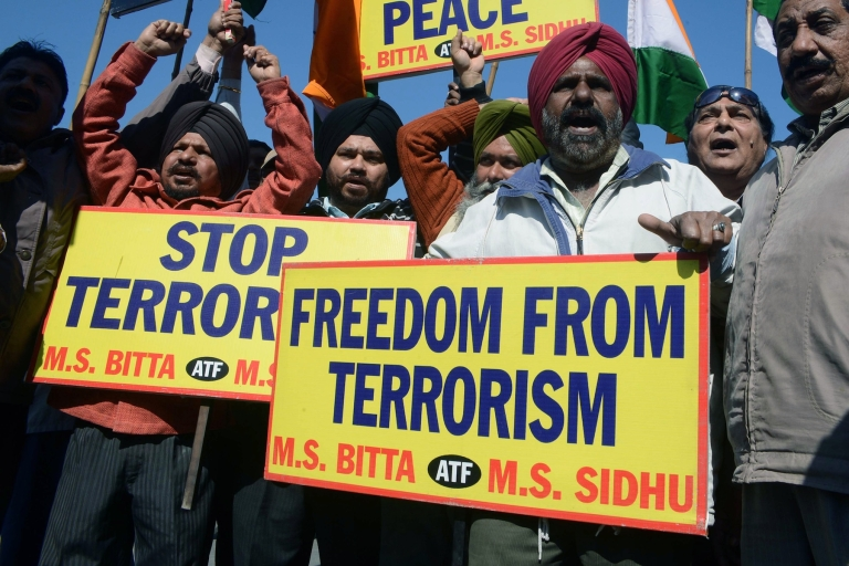<p>All India Anti Terrorist Front (AIATF) activists shout slogans as they celebrate the execution of Mohammed Afzal Guru, in Amritsar on February 9, 2013. A Kashmiri separatist was executed Saturday over his role in a deadly attack on parliament in New Delhi in 2001, an episode that brought nuclear-armed India and Pakistan to the brink of war.</p>